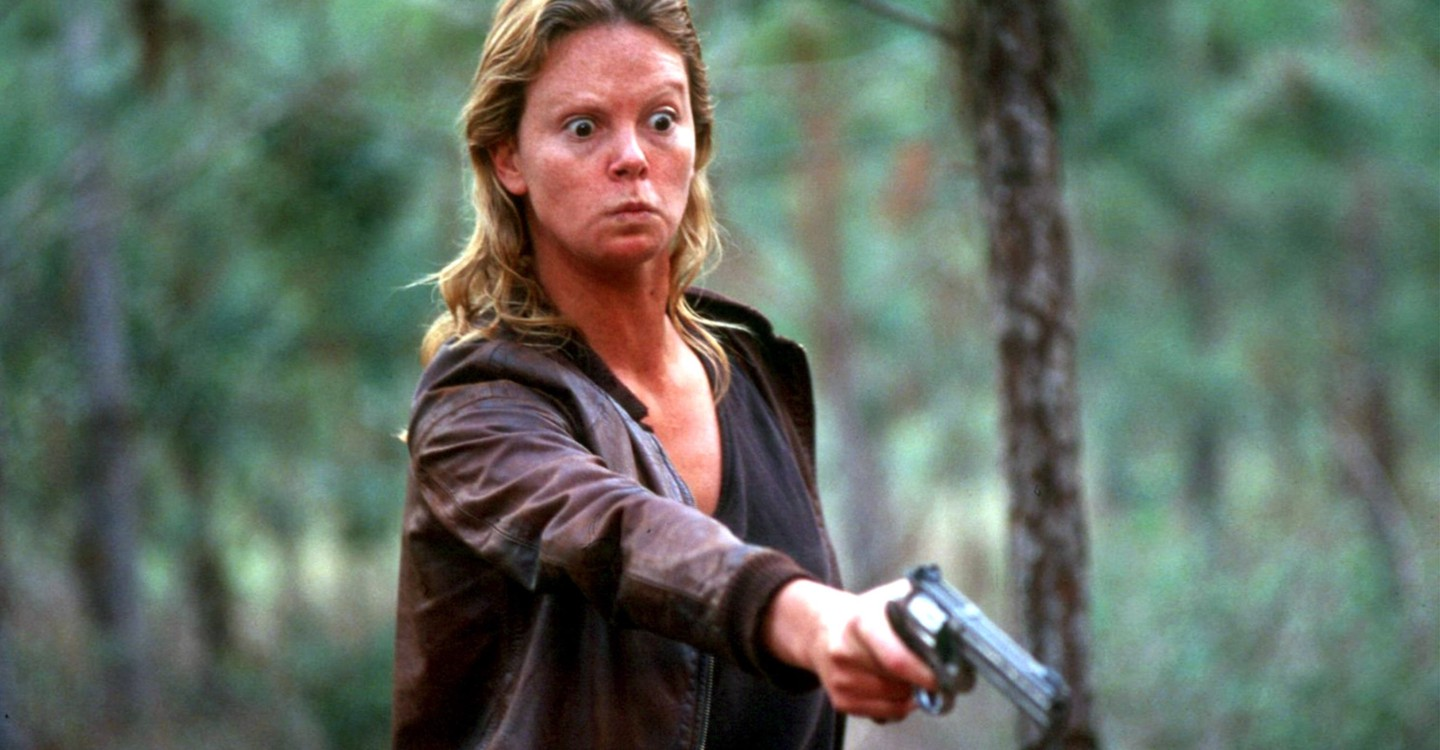 Aileen (Charlize Theron) wields gun against one of her victims in Monster (2003)