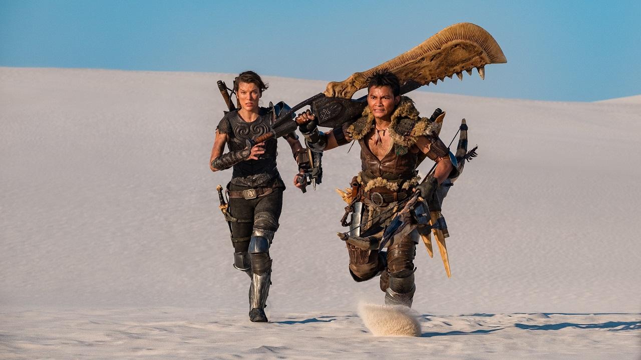 Artemis (Milla Jovavich) and Hunter (Tony Jaa) wielding The Great Sword in Monster Hunter (2020)