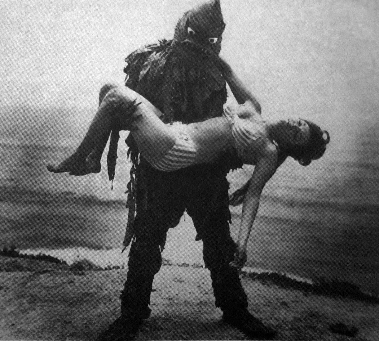 The monster carries a girl away in Monster from the Surf (1965)