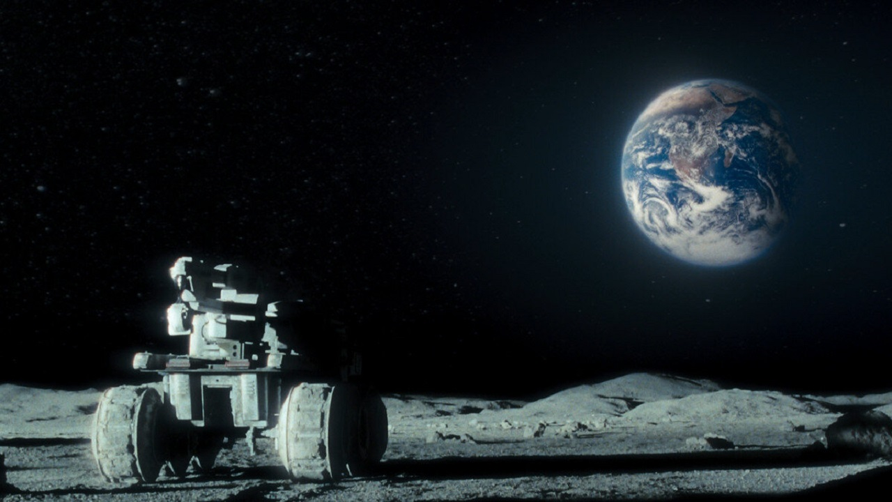 Buggy on The Moon's surface and Earth overhead in Moon (2009)