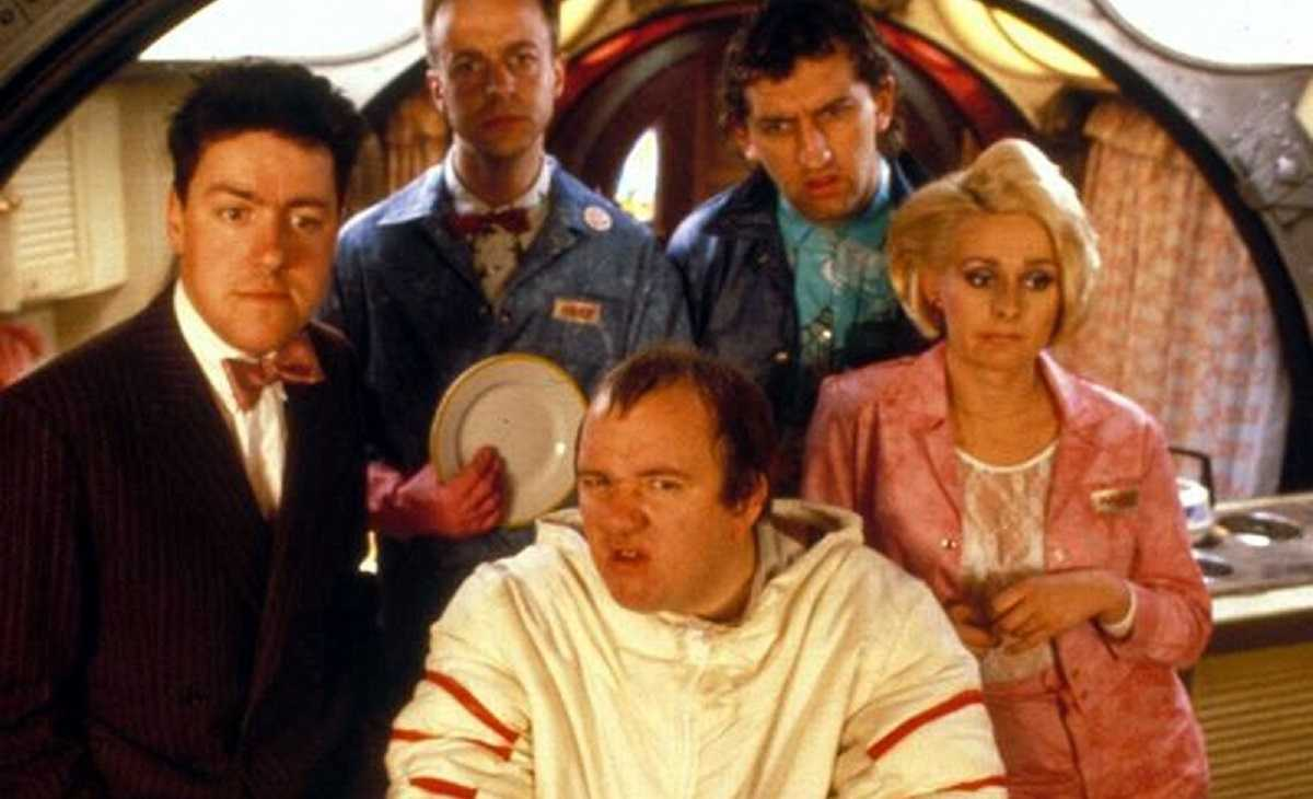 Griff Rhy-Jones, Mel Smith and the morons Paul Brown, Jimmy Nail and Joanne Pearce in Morons from Outer Space (1985)