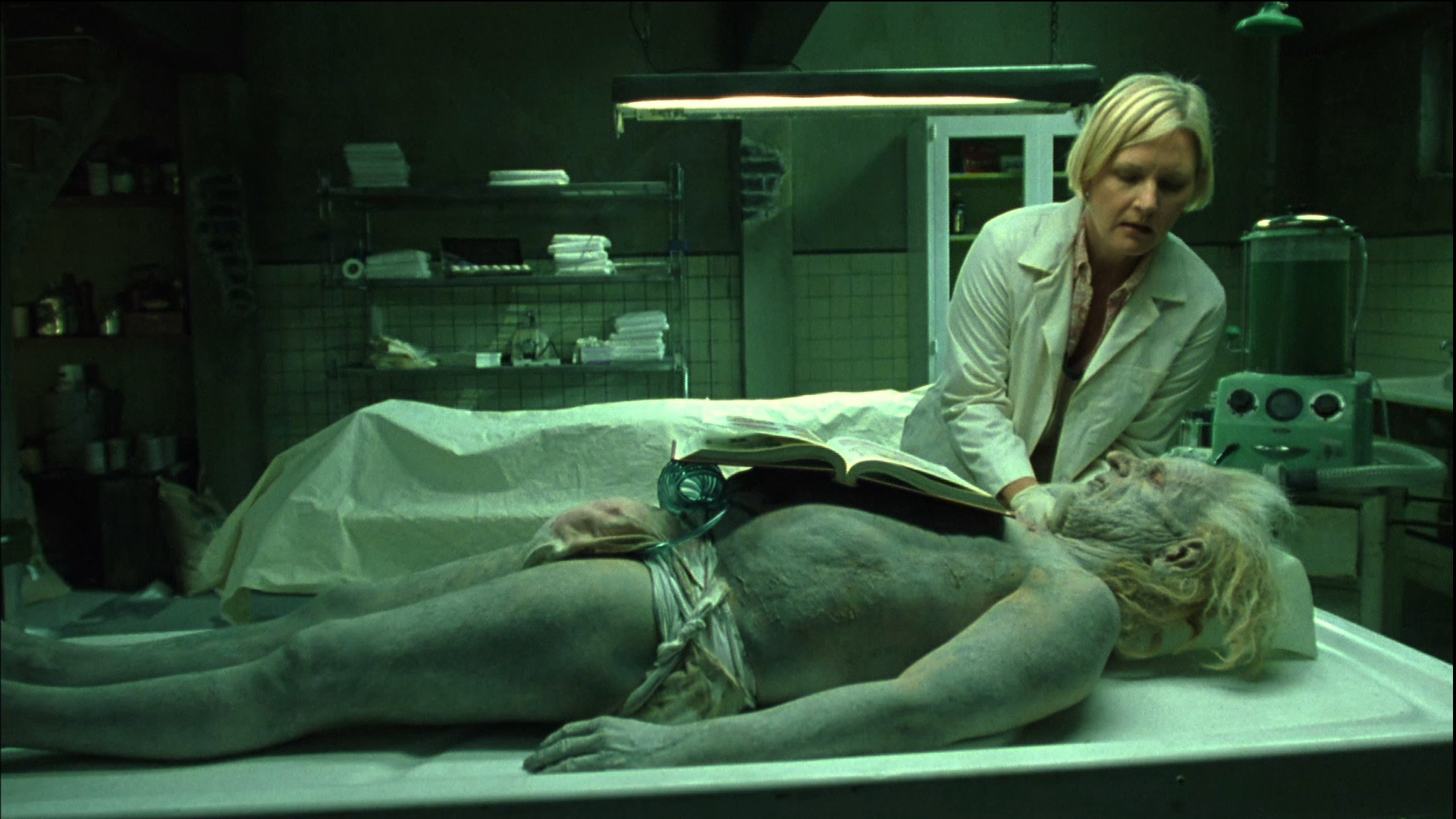 Denise Crosby at work on a corpse in the Mortuary (2005)