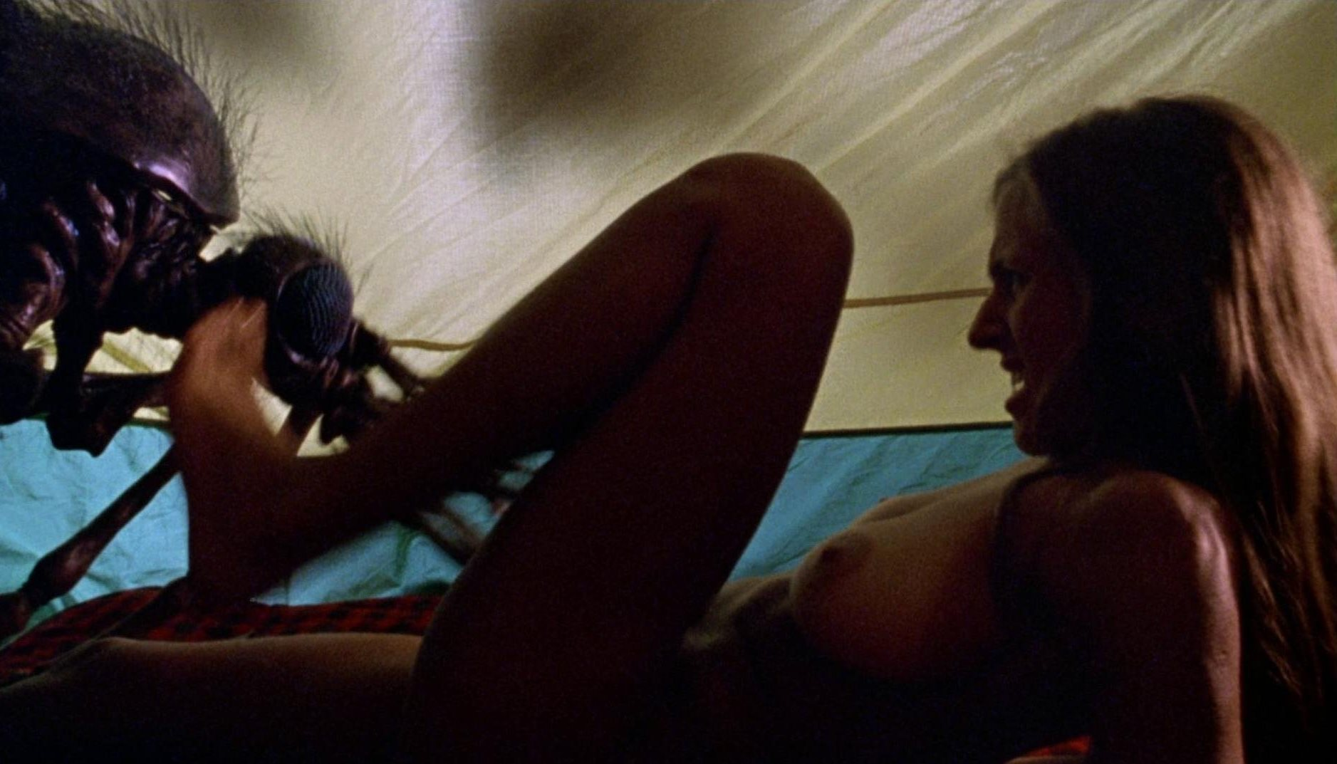 Margaret Gomoll wakes up in a tent wit a giant Mosquito (1995)
