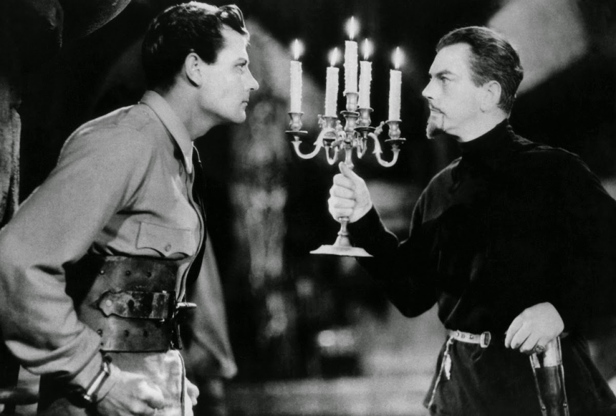 Shipwreck survivor Joel McCrea confronts Count Zaroff (Leslie Banks) in The Most Dangerous Game (1932)