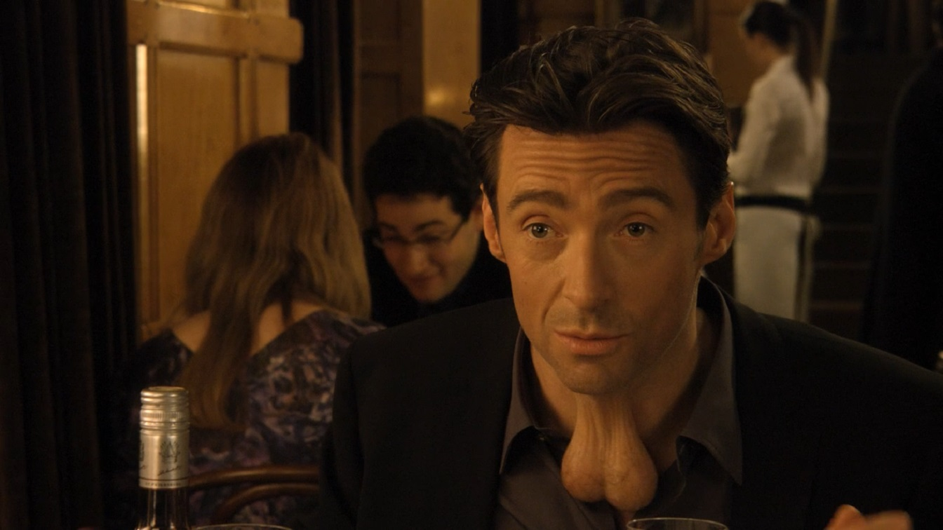 Hugh Jackman with a pair of testicles on his neck in Movie 43 (2013)