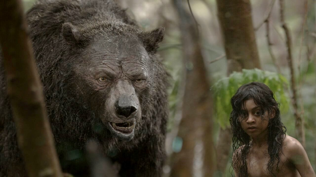 (l to r) Baloo (a mocapped Andy Serkis, also the film's director) and Mowgli (Rohan Chand) in Mowgli (2018)