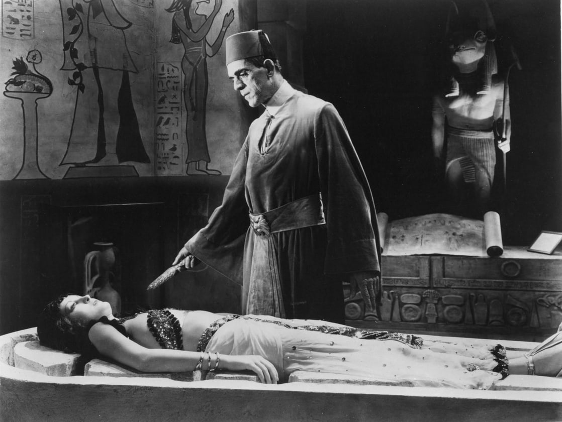 Boris Karloff prepares to conduct a ritual to resurrect his lost love in Zita Johann in The Mummy (1932)