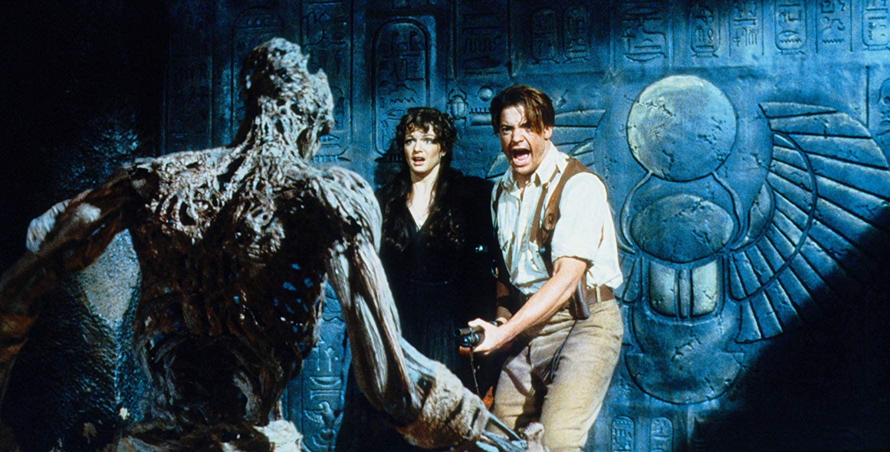 Rachel Weisz and Brendan Fraser face a zombified priest in The Mummy (1999)
