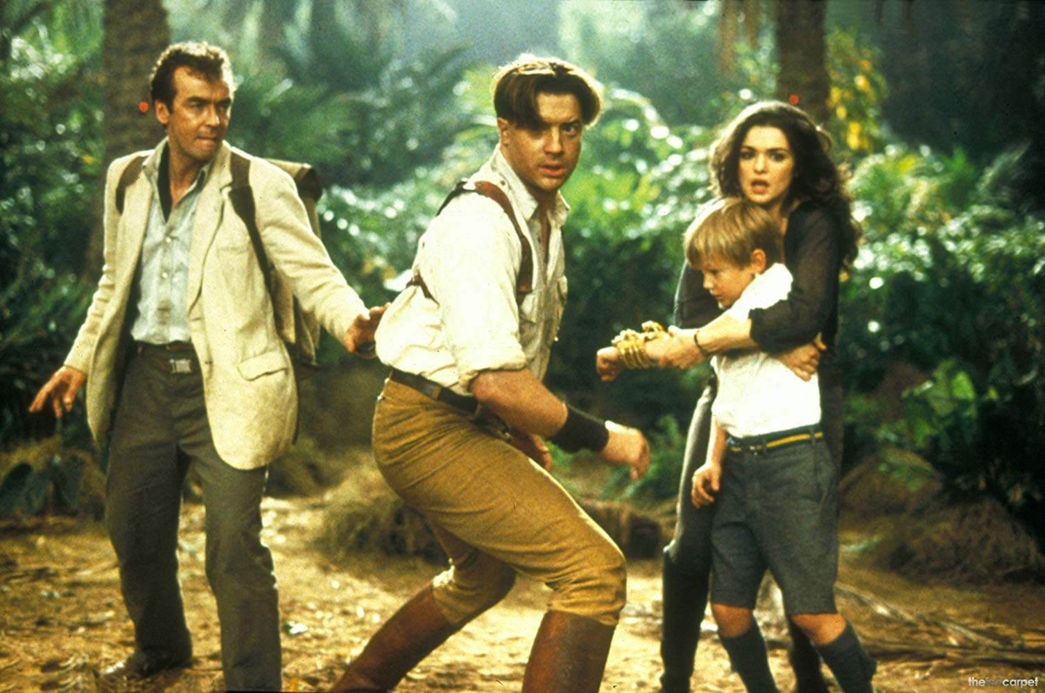 Back in action - Jonathan Carnahan (John Hannah), Rick Carter (Brendan Fraser), Evelyn (Rachel Weisz) who is now his wife and their son Alex (Freddie Boath) in The Mummy Returns (2001)