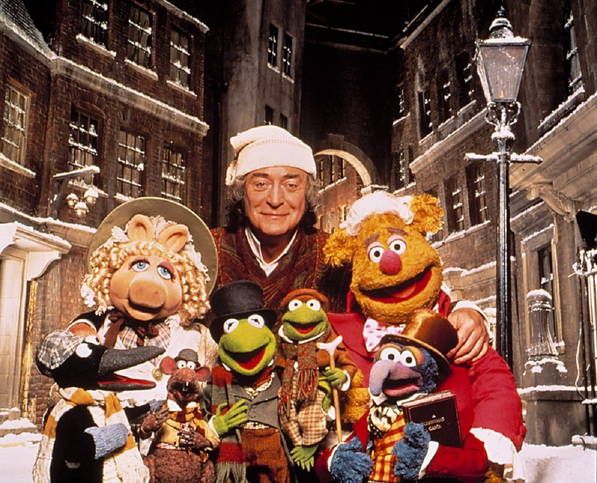 Scrooge (Michael Caine) surrounded by The Muppets in The Muppet Christmas Carol (1992)