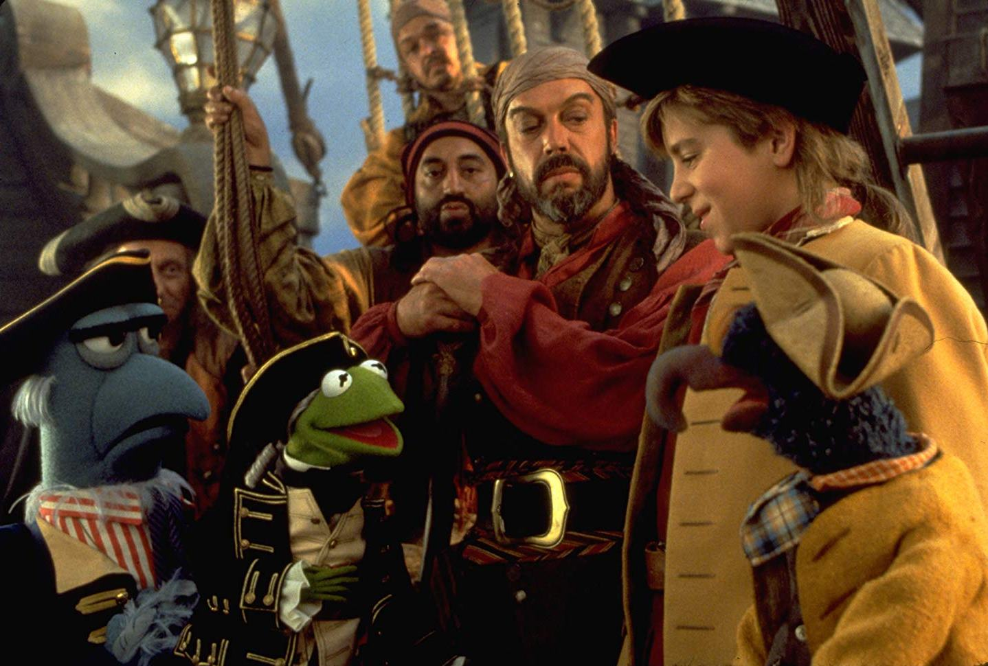 The Muppets with Long John Silver (Tim Curry) and Jim Hawkins (Kevin Bishop) in Muppet Treasure Island (1996)