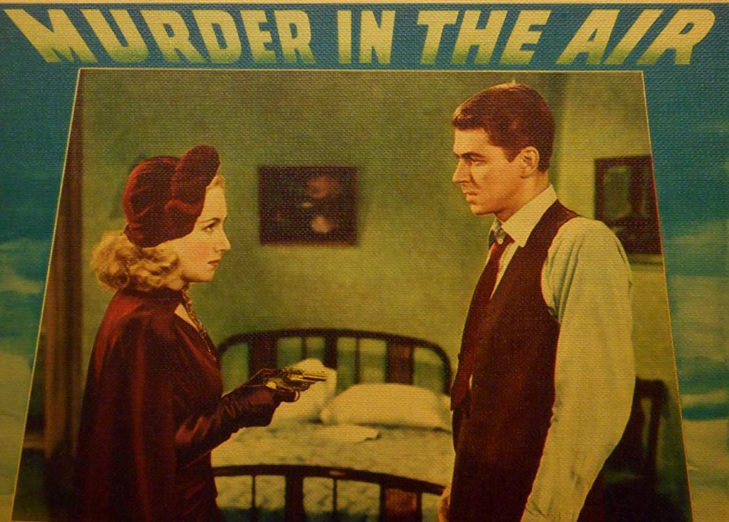 Ronald Reagan as Treasury agent Brass Bancroft along with Lya Lys in Murder in the Air (1940)