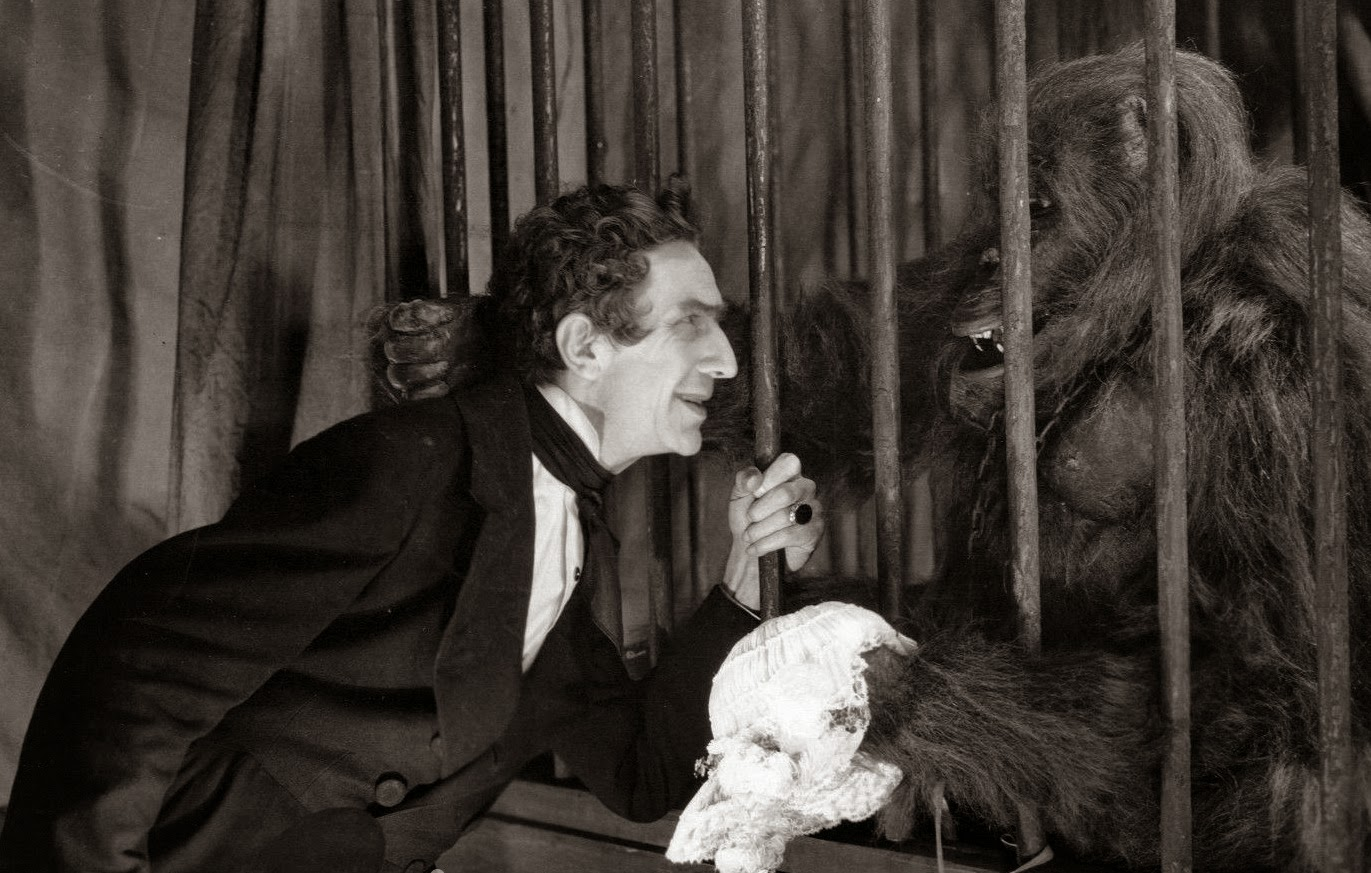 Dr Mirakle (Bela Lugosi) and his gorilla Erik in Murders in the Rue Morgue (1932)