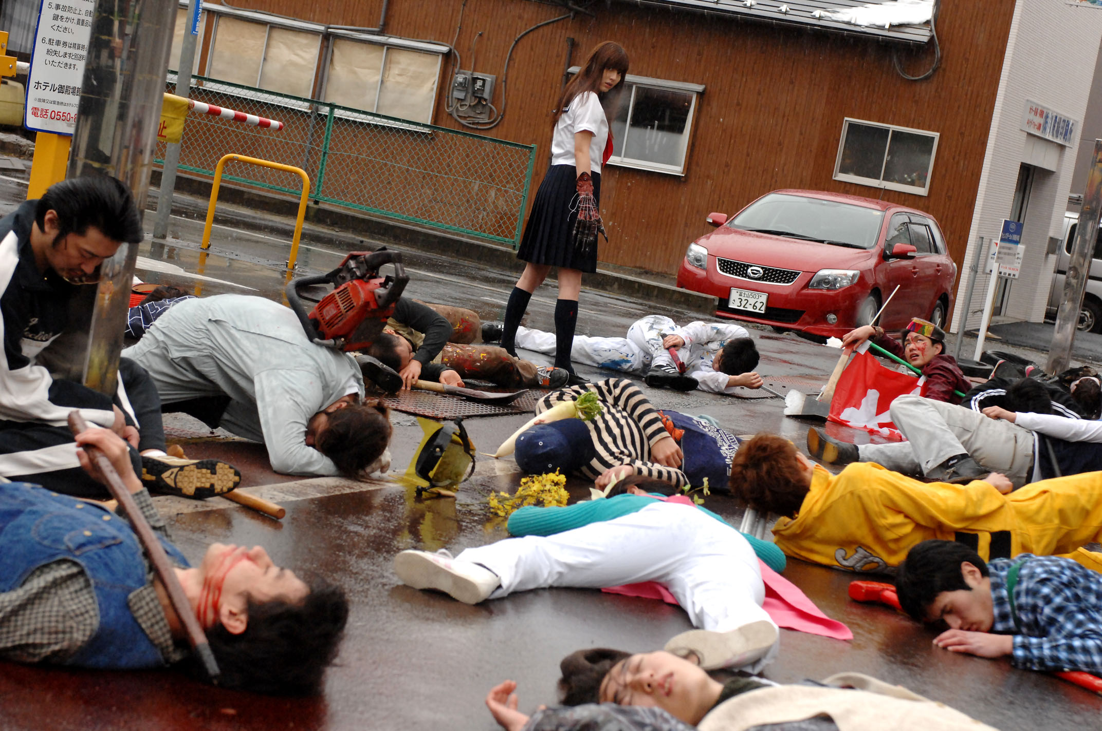Yumi Sugimoto slaughters an entire street with her claw in Mutant Girls Squad (2010)