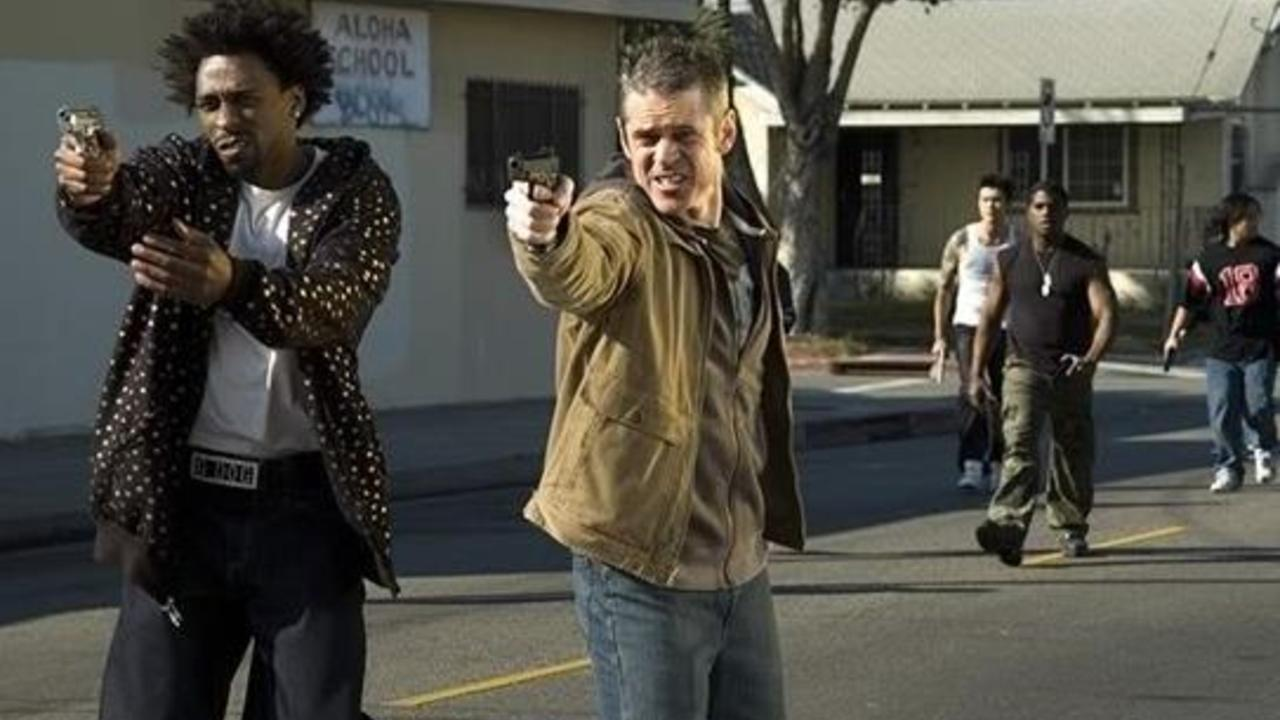 Gang leader Tyshawn Bryant and white cop C. Thomas Howell deal with the zombie apocalypse in Mutant Vampire Zombies from the 'Hood (2008)