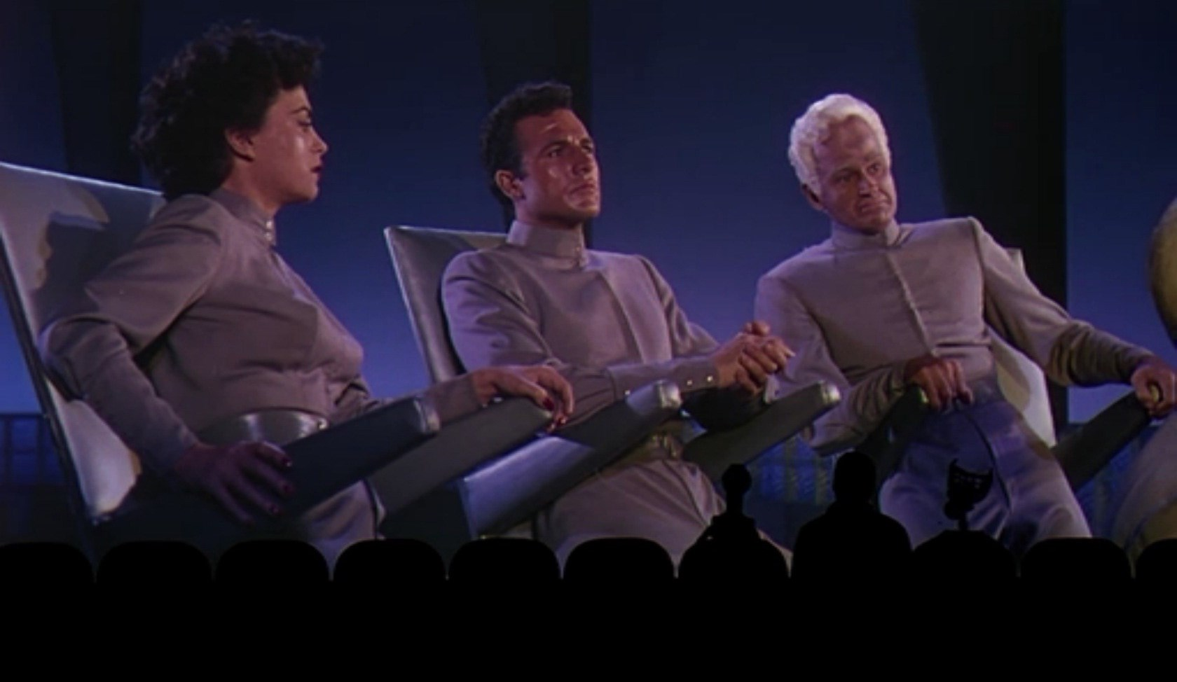 (l to r) Tom Servo (voiced by Kevin Murphy), Mike Nelson and Crow T. Robot (voiced by Trace Beaulieu) sit down to make fun of This Island Earth in Mystery Science Theater 3000: The Movie (1996)