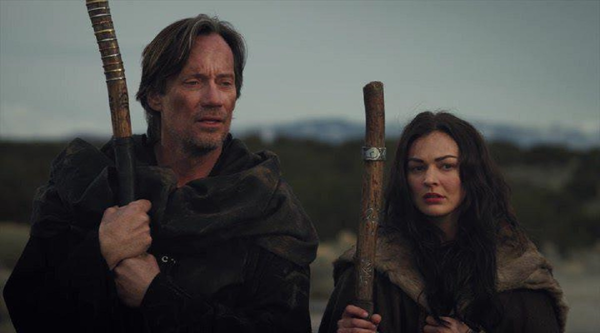 Marek (Melanie Stone) and her mentor Gojun Pye (Kevin Sorbo) in Mythica: The Necromancer (2015)