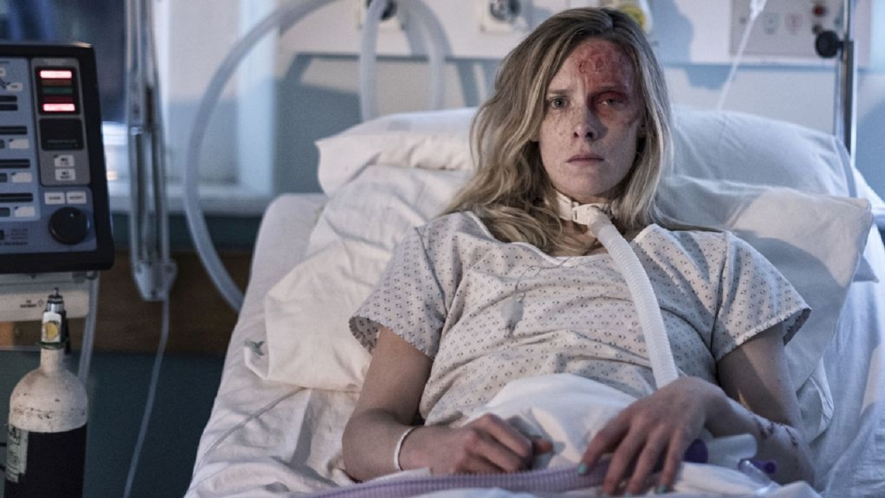 A hospitalised Shauna MacDonald in Nails (2017)