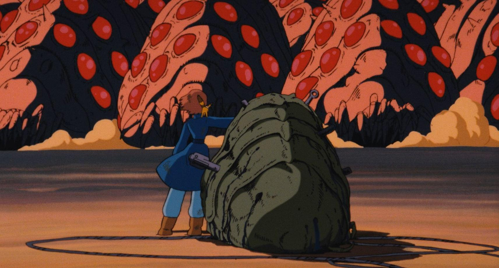 Nausicaa stands in the path of the sea of Ohms in Nausicaa in the Valley of the Wind (1984)