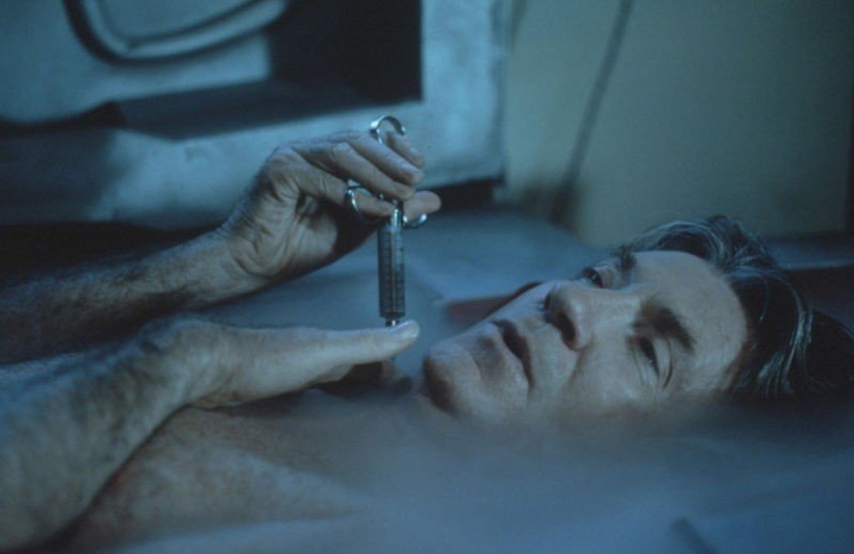 David Warner injects himself in The Cold episode of Necronomicon (1993)
