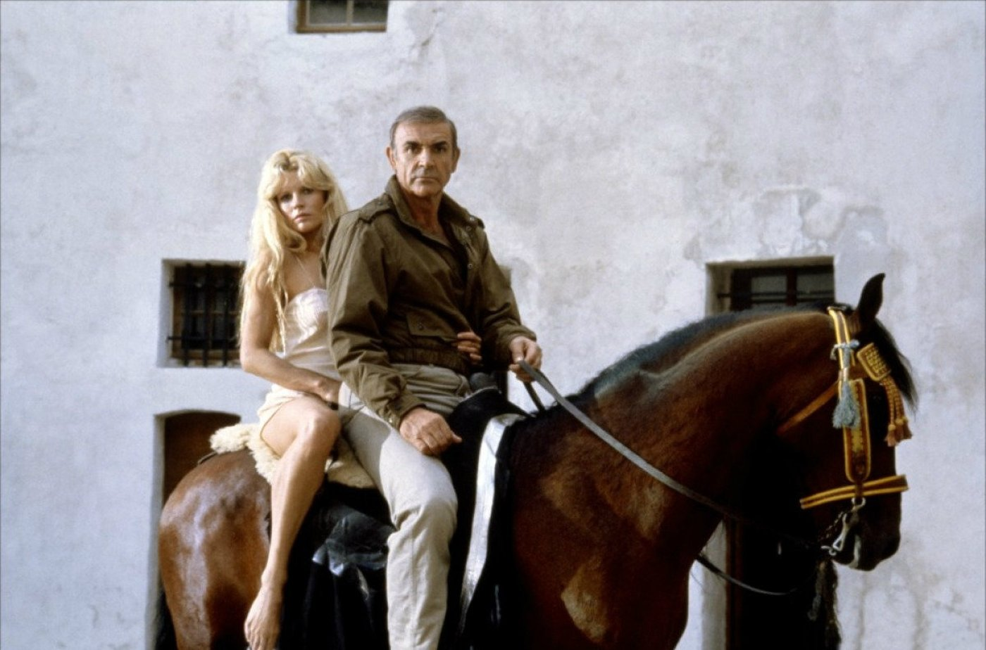 James Bond (Sean Connery) and Domino (Kim Basinger) escape on horseback in Never Say Never Again (1983)