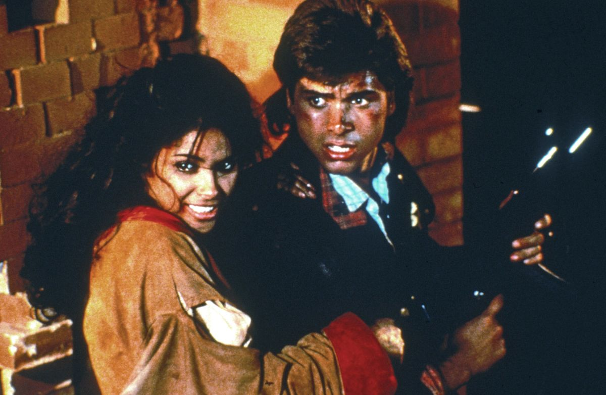 John Stamos and Vanity in Never Too Young to Die (1986)