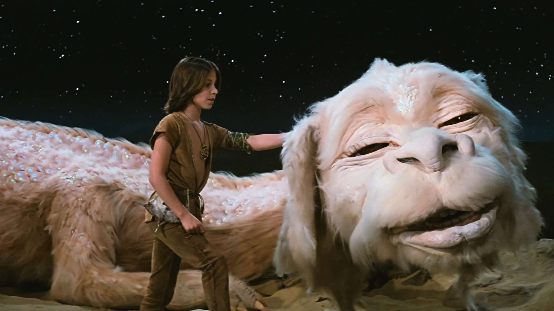 Noah Hathaway as Atreyu along with his Luckdragon in The NeverEnding Story (1984)