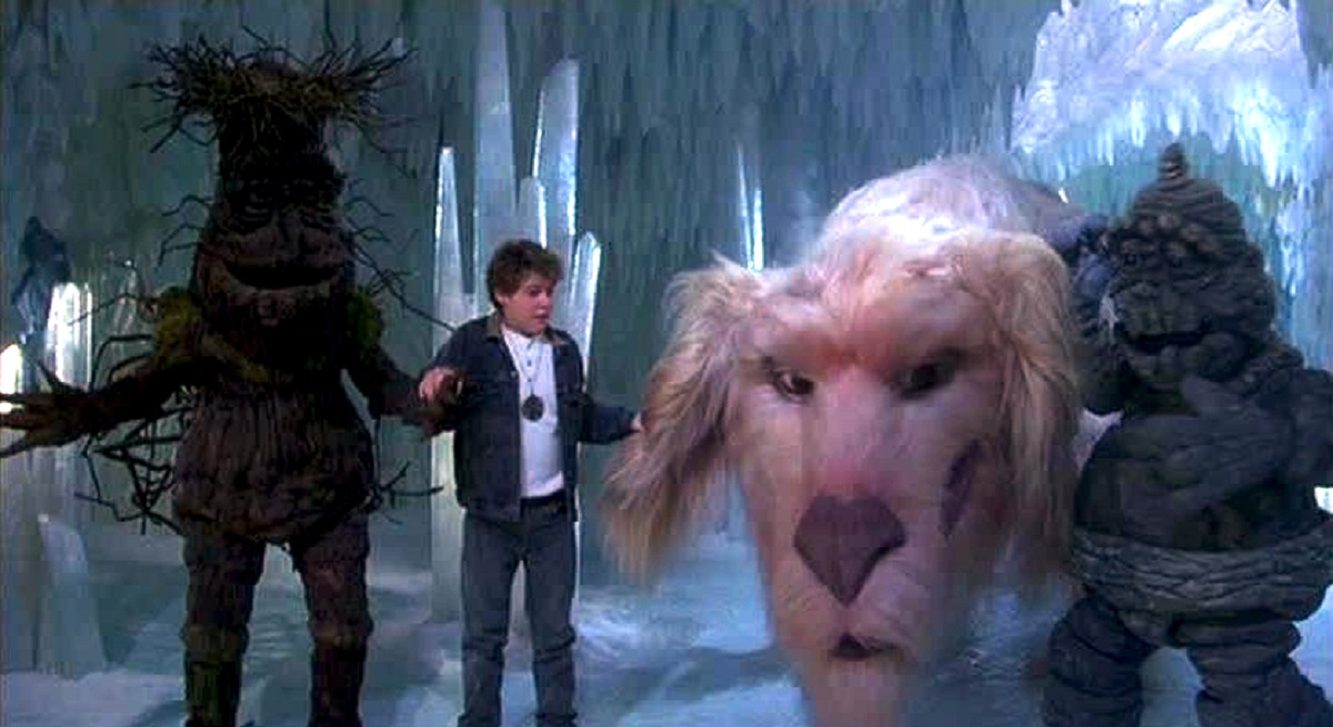 Bastian (Jason James Richter) surrounded by (l to r) Barky, The Luckdragon and Junior Rockbiter in The Neverending Story III (1994)