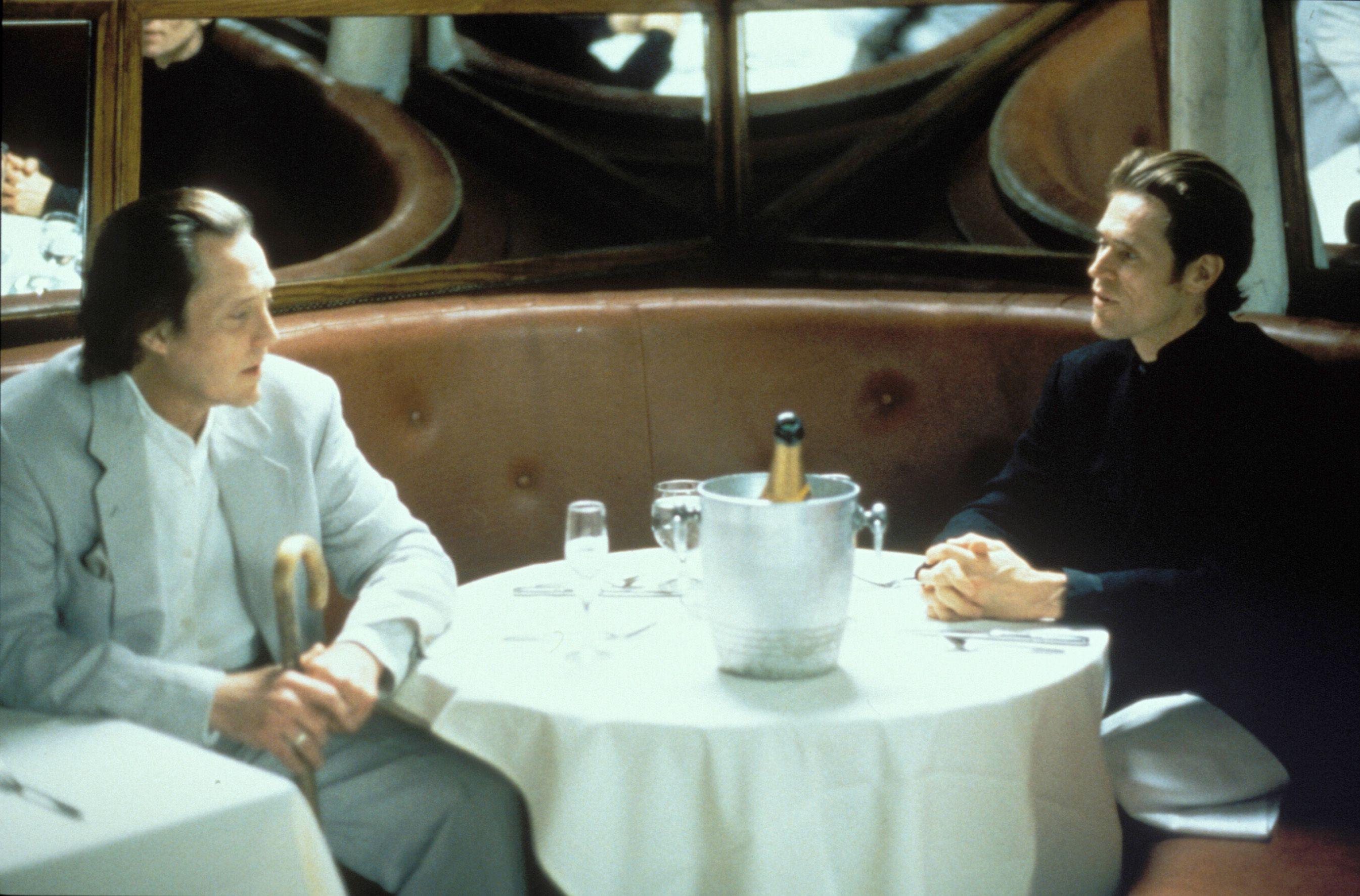 Christopher Walken and Willem DaFoe plot industrial espionage in New Rose Hotel (1998)