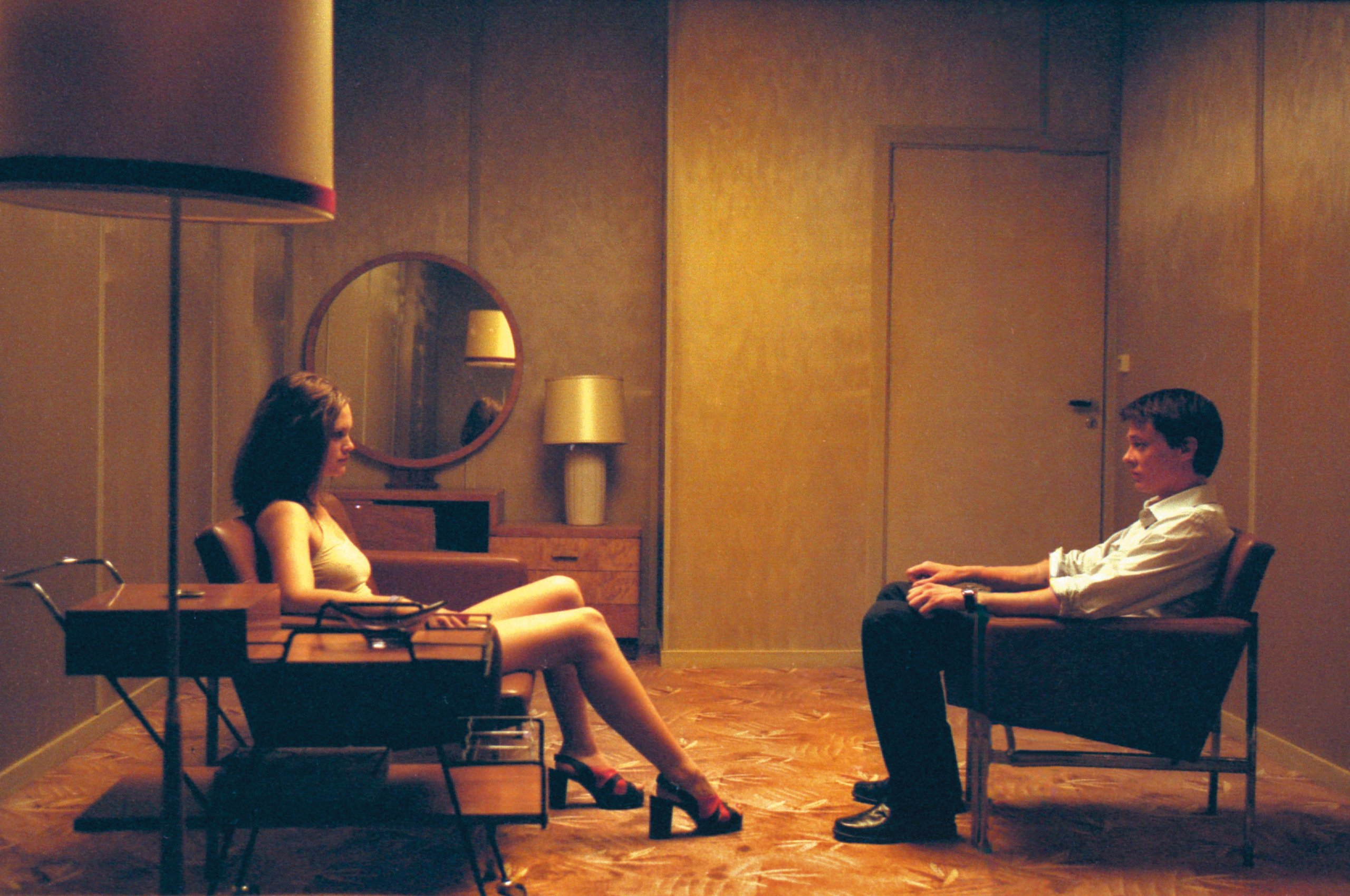 Kristoffer Joner sits down as Julia Schacht recounts the story of her assault in Next Door (2005)