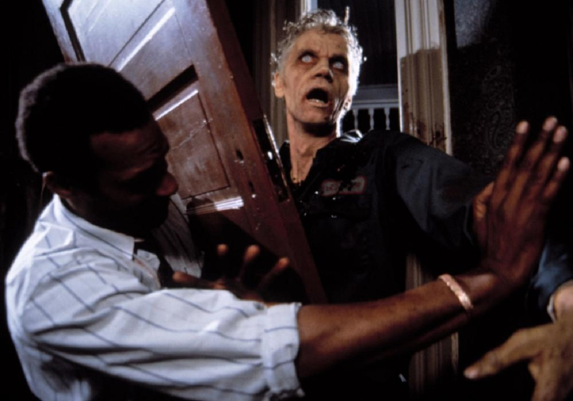 Ben (Tony Rodd) fends off the zombies in Night of the Living Dead (1990)