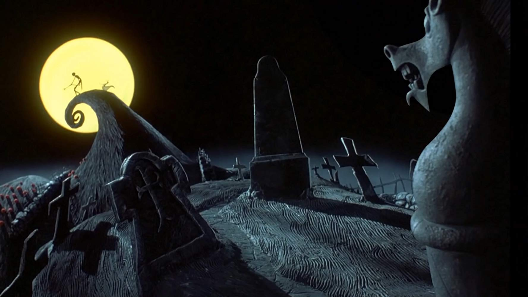 Jack Skellington stands over the graveyard in Halloween Town in The Nightmare Before Christmas (1993)