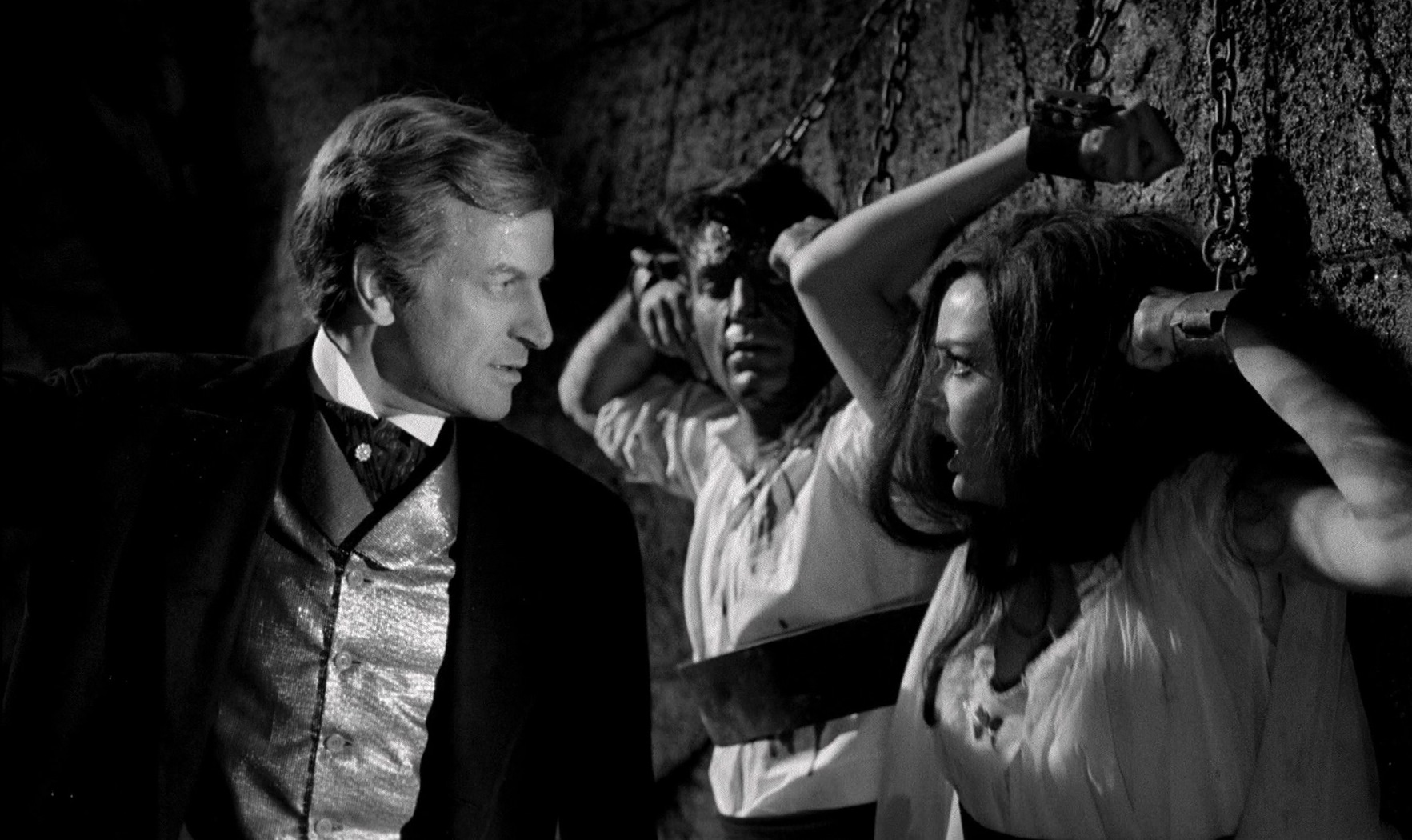 Paul Muller chains Barbara Steele and her lover Rik Battaglia up in the dungeon in Nightmare Castle (1965)