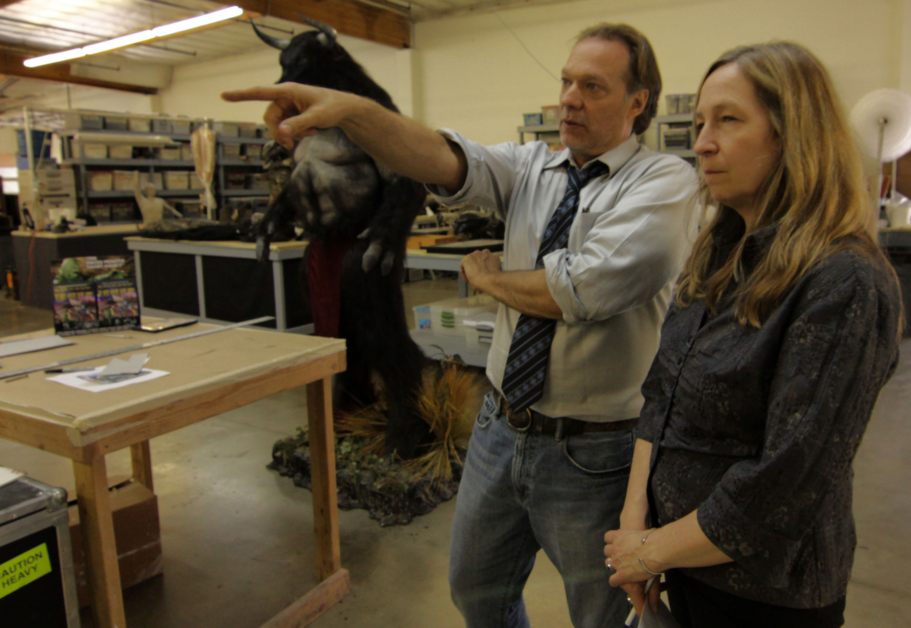 Greg Nicotero shows director Donna Davies around the K.N.B studio in Nightmare Factory (2011)