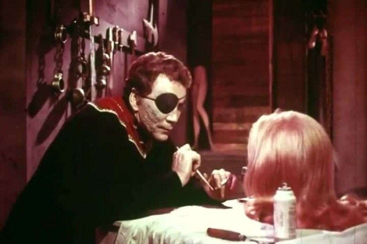 Mad waxwork curator Vincent Rinard (Cameron Mitchell) at work on one of his creations in Nightmare in Wax (1969)