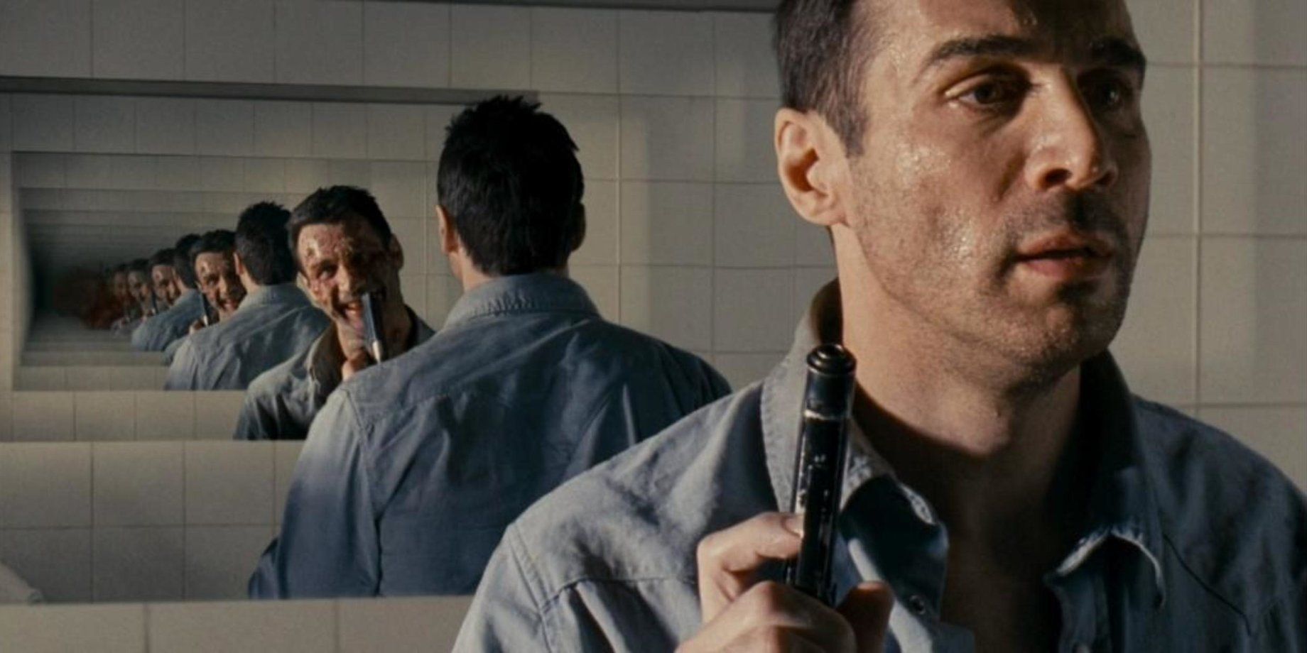 Adrian Paul haunted by his own reflection in Nine Miles Down (2009)