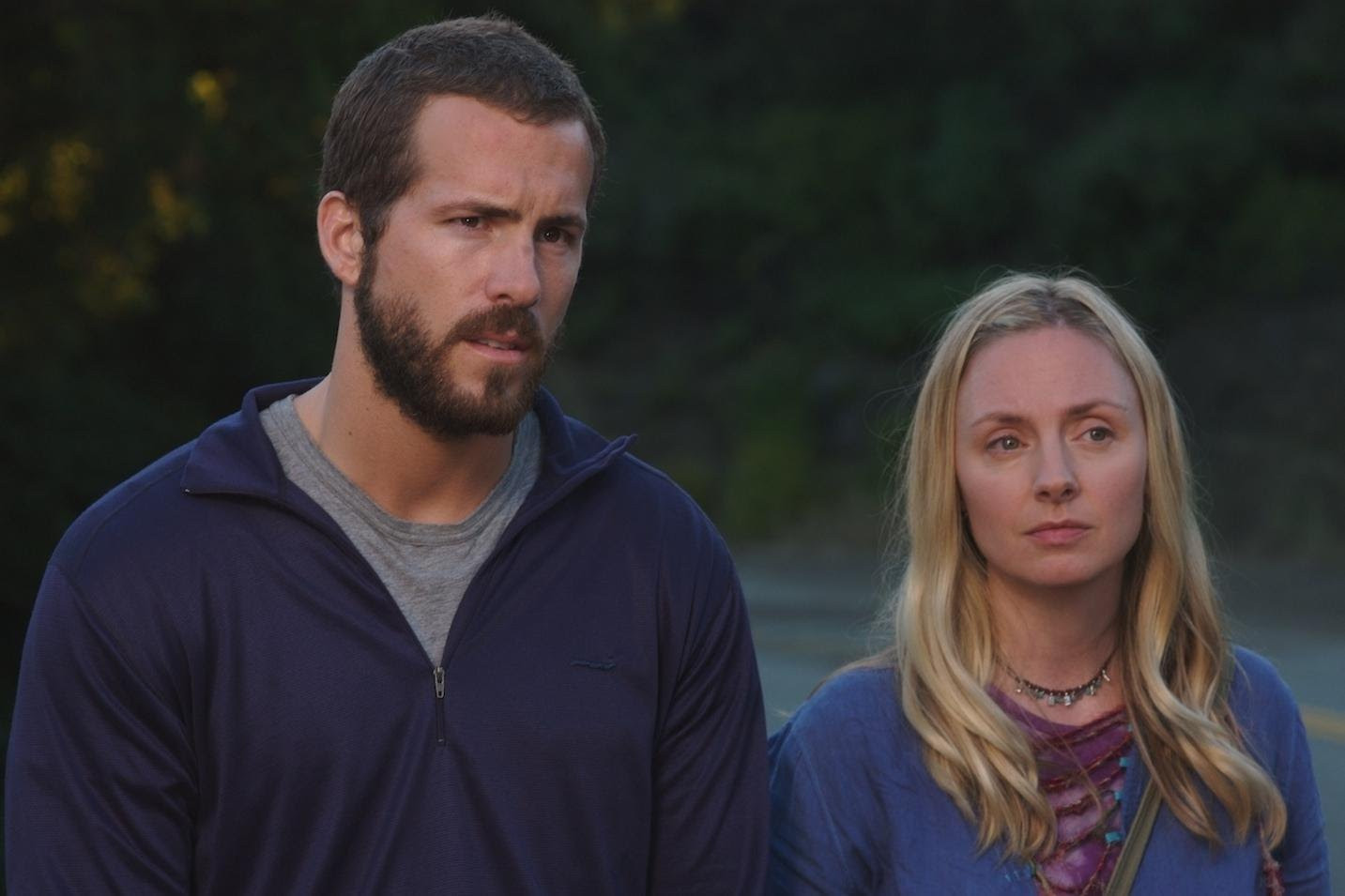 Ryan Reynolds and neighbour Hope Davis in The Nines (2007)