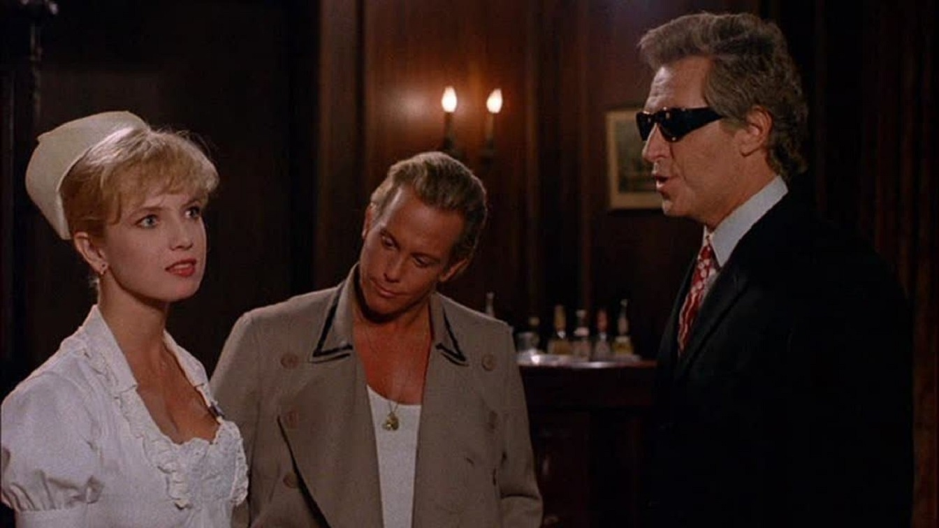 (l to r) Nurse Traci Lords, chauffeur Lenny Juliano and the mysterious Mr Johnson (Arthur Roberts) in Not Of This Earth (1988)
