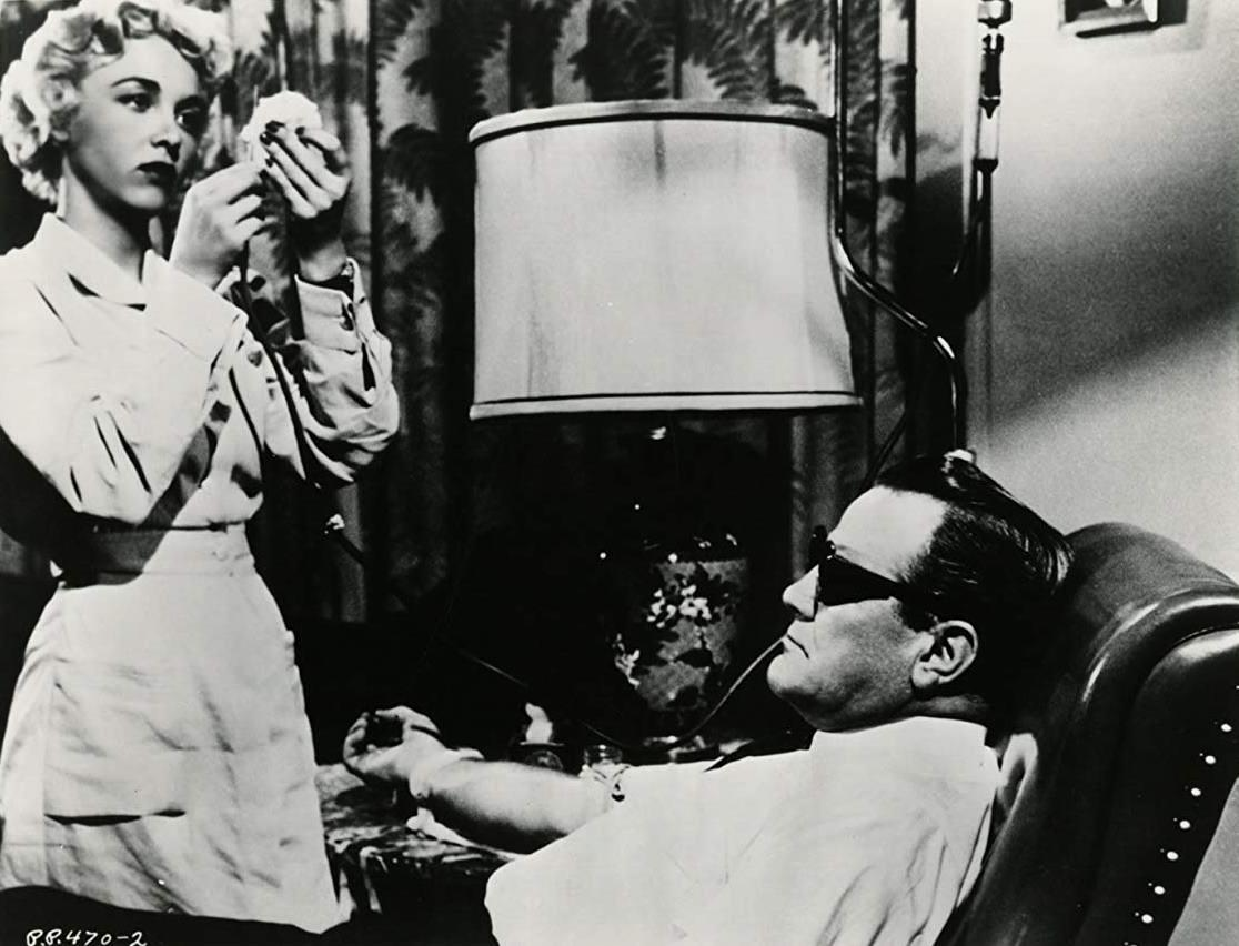 Nurse Beverly Garland administers Mr Johnson (Paul Birch)'s injection in Not of This Earth (1957)