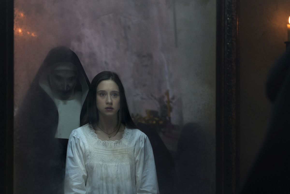 The Nun appears to Sister Irene (Taissa Farmiga) in The Nun (2018)