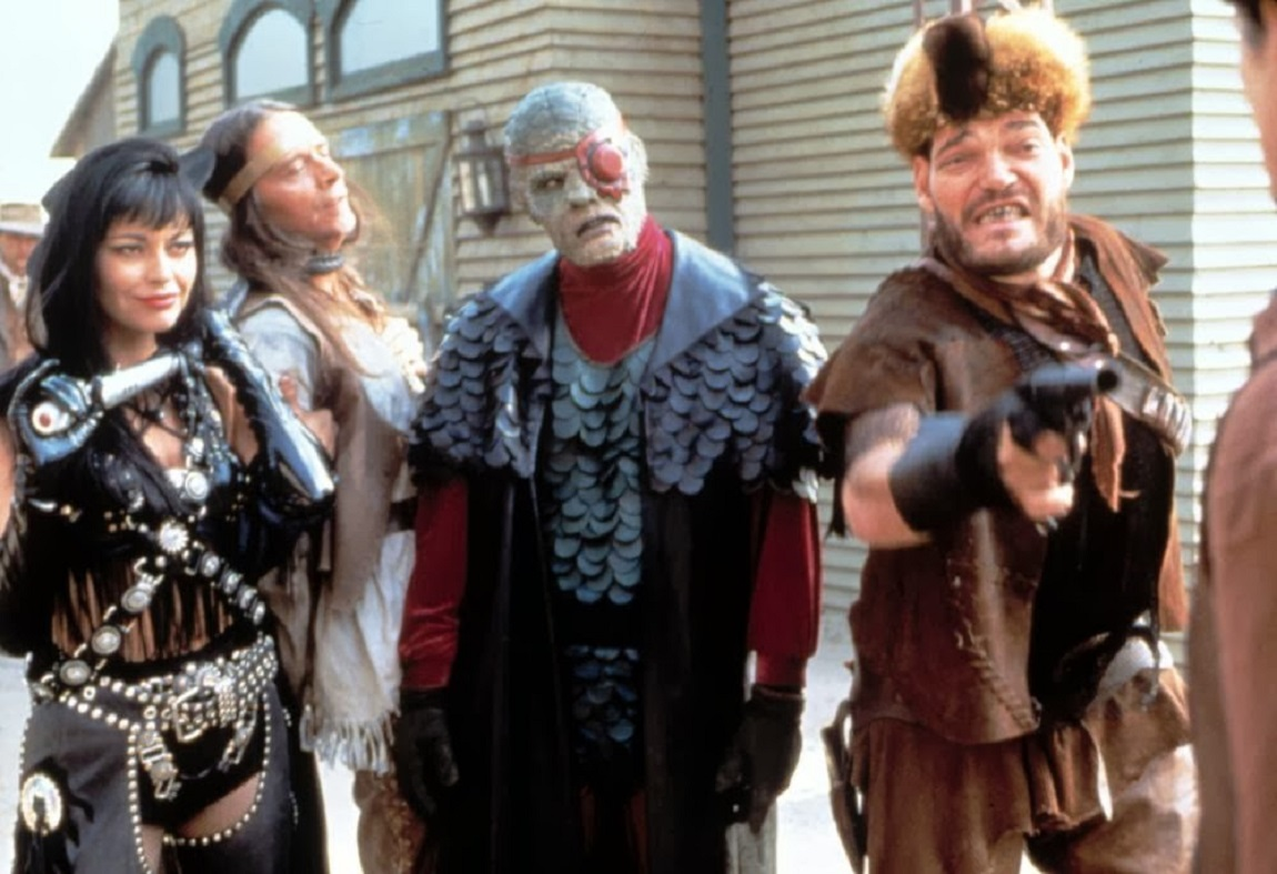 Redeye and his gang arrive in town - (l to r) Lash (Musetta Vander), Buteo (Jimmie F. Skaggs), Redeye (Andrew Divoff) and Bork (Irwin Keyes) in Oblivion (1994)