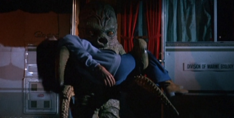 The Octaman abducts a victim in Octaman (1971)