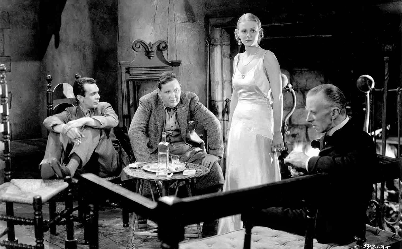 The visitors to the Femm house - Melvyn Douglas, Charles Laughton, Gloria Stuart and host Ernest Thesiger in The Old Dark House (1932)