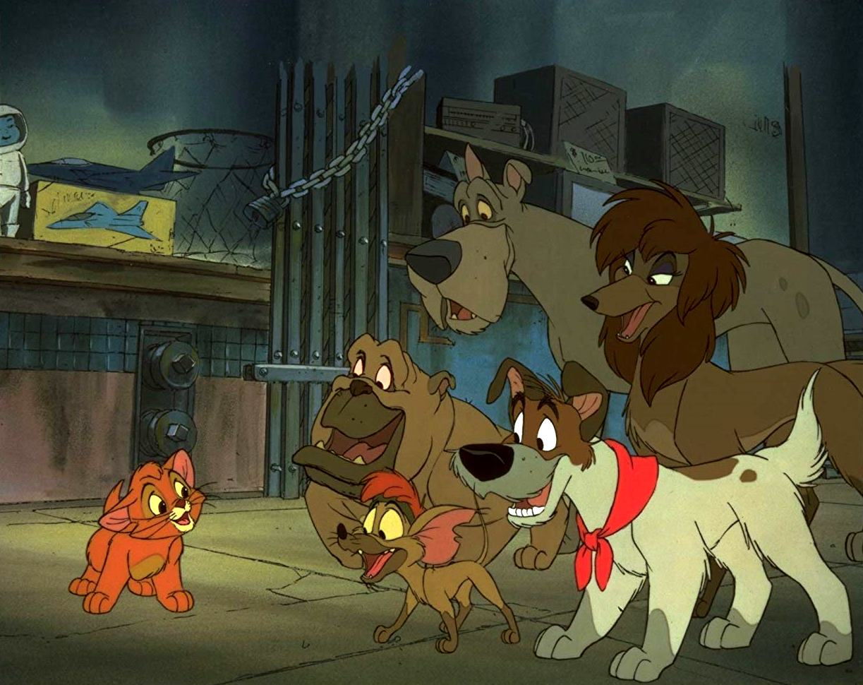 Oliver (voiced by Joey Lawrence) (l) falls in with Dodger (voiced by Billy Joel) (bottom r) and his company of stray dogs in Oliver & Company (1988)