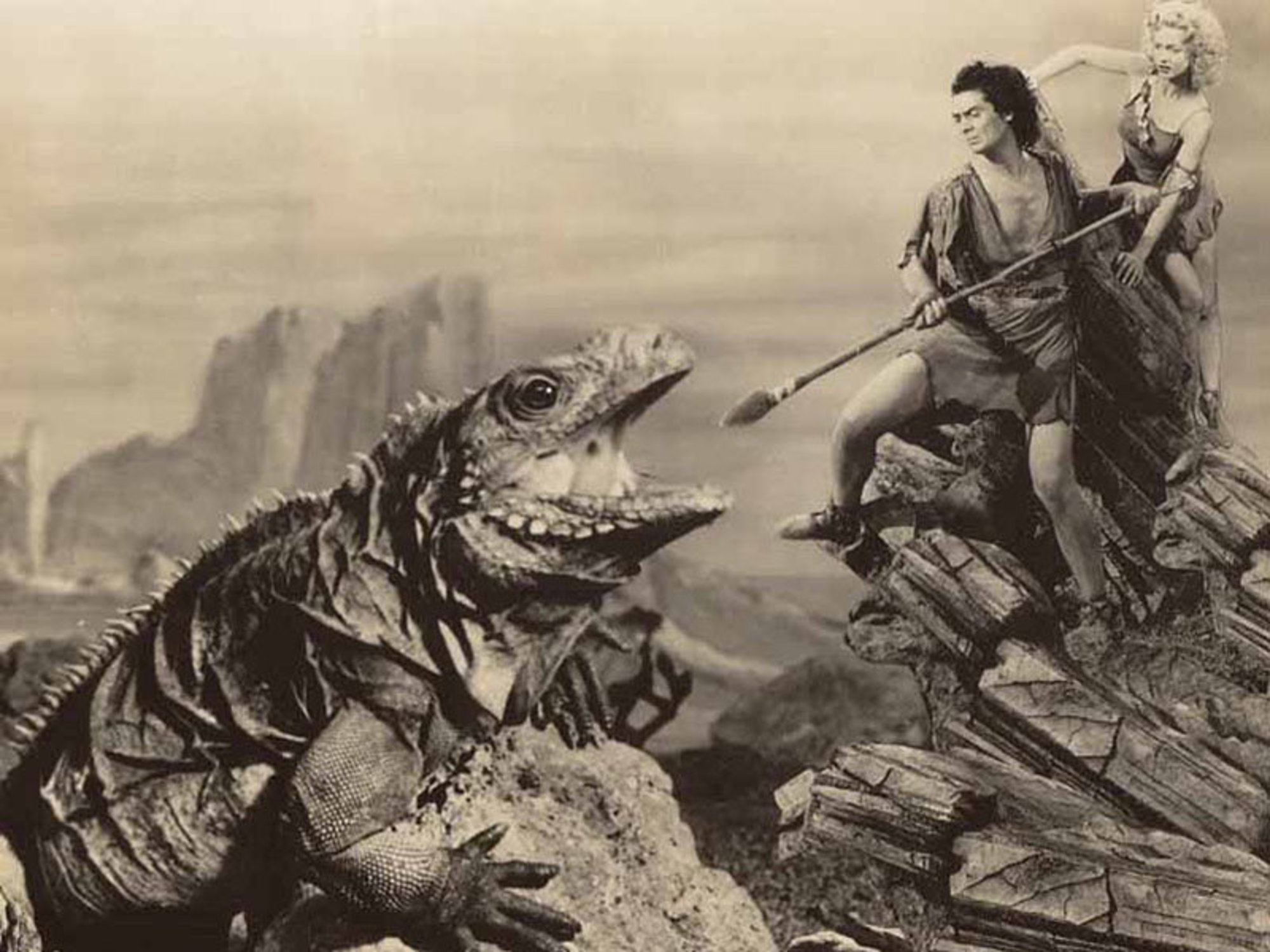 Victor Mature fends off a dinosaur attack to protect Carole Landis in One Million B.C. (1940)