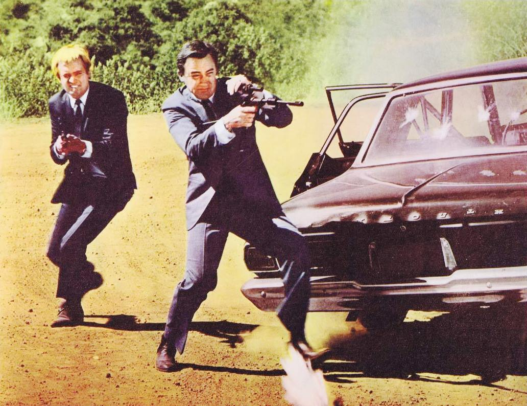 U.N.C.L.E. agents (l to r) Ilya Kuryakin (David McCallum) and Napoleon Solo (Robert Vaughn) in action in One Spy Too Many (1966)