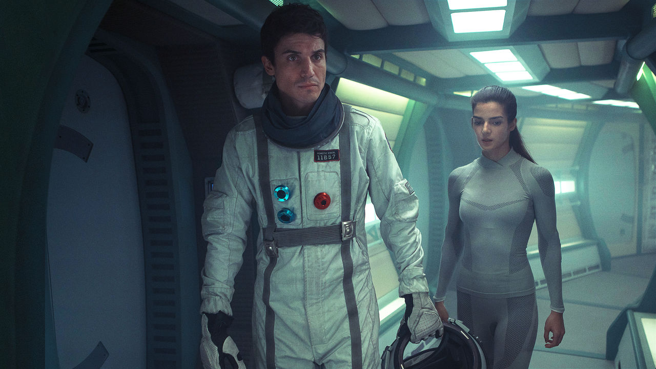 Helena (Clara Lago), lone girl on a space mission and Alex (Alex Gonzalez), the first other person she has met in Orbiter 9 (2016)