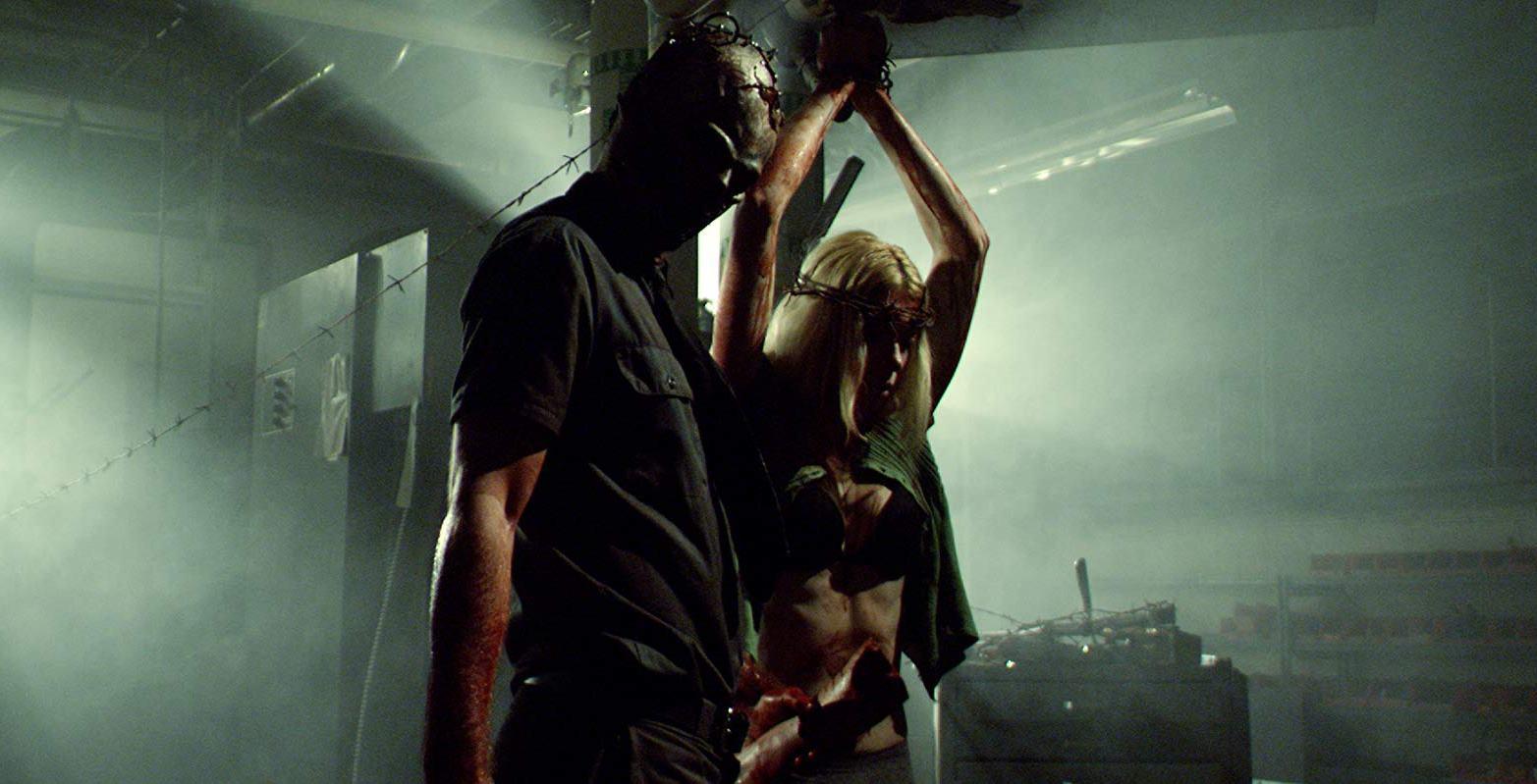 The Orphan Killer (David Backhaus) with heroine Diane Foster a prisoner in The Orphan Killer (2011)