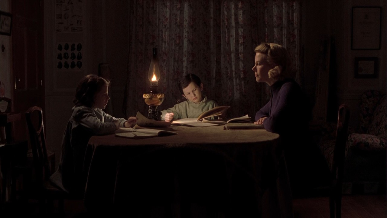 Nicole Kidman (r) and children Alakina Mann and James Bentley in a haunted house in The Others (2001)