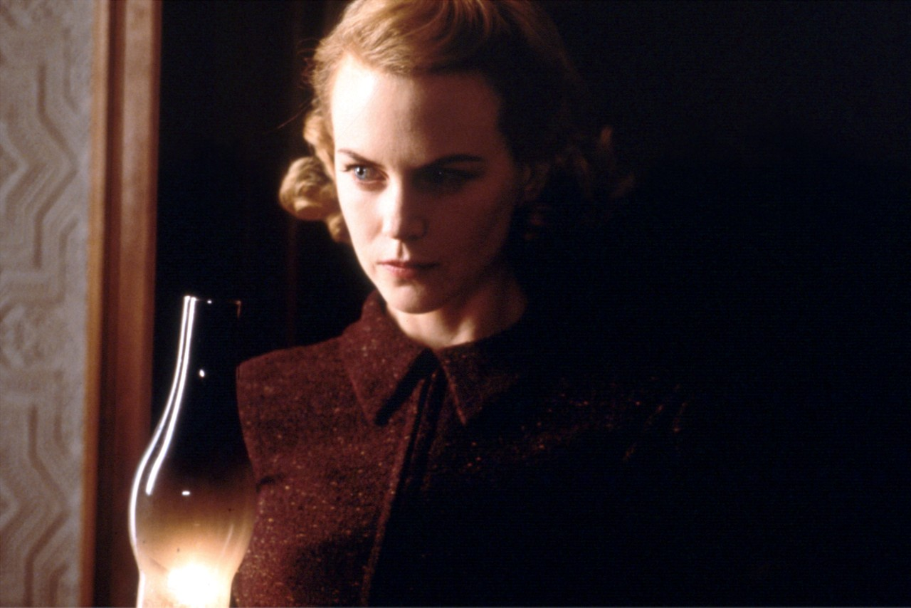 Grace (Nicole Kidman) in search of ghosts in the house in The Others (2001)